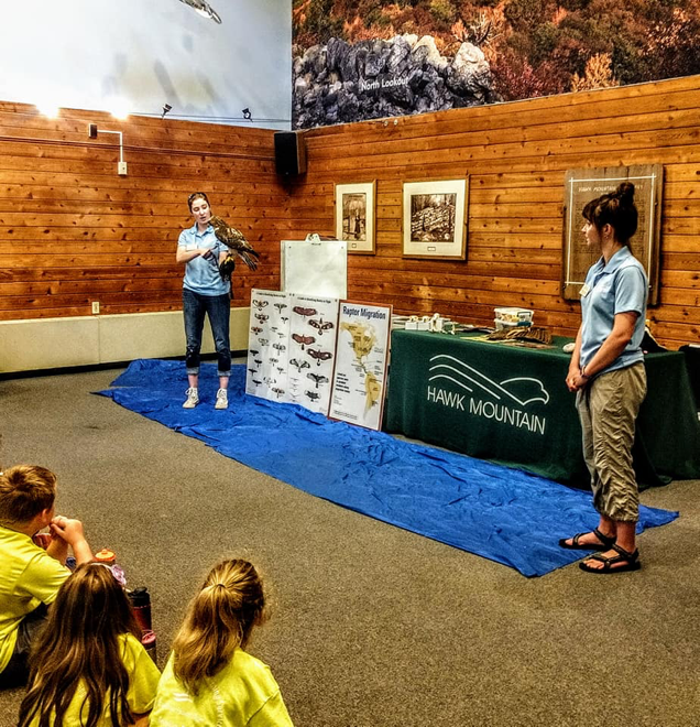 Education Trainees Diana and Alyssa host a Raptors Over the Ridge School Program in the Visitor Center
