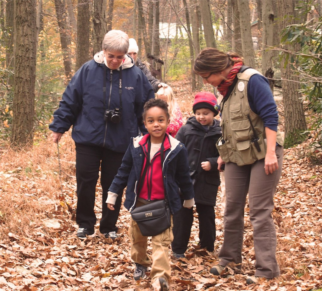 Educator Rachel guides young students on the trails