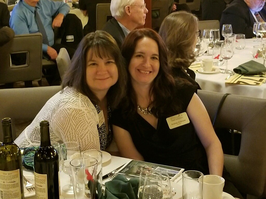 Educator Andrea Ambrose and Volunteer Cheryl Faust pose together at the Benefit for the Birds Gala