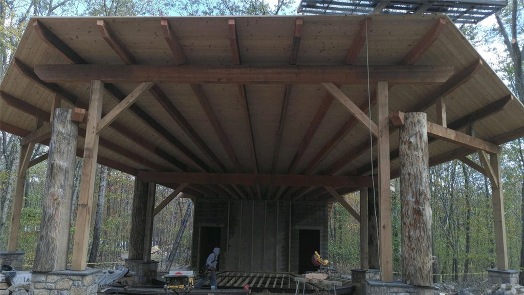 Outdoor amphitheater in progress, with structure and roof.