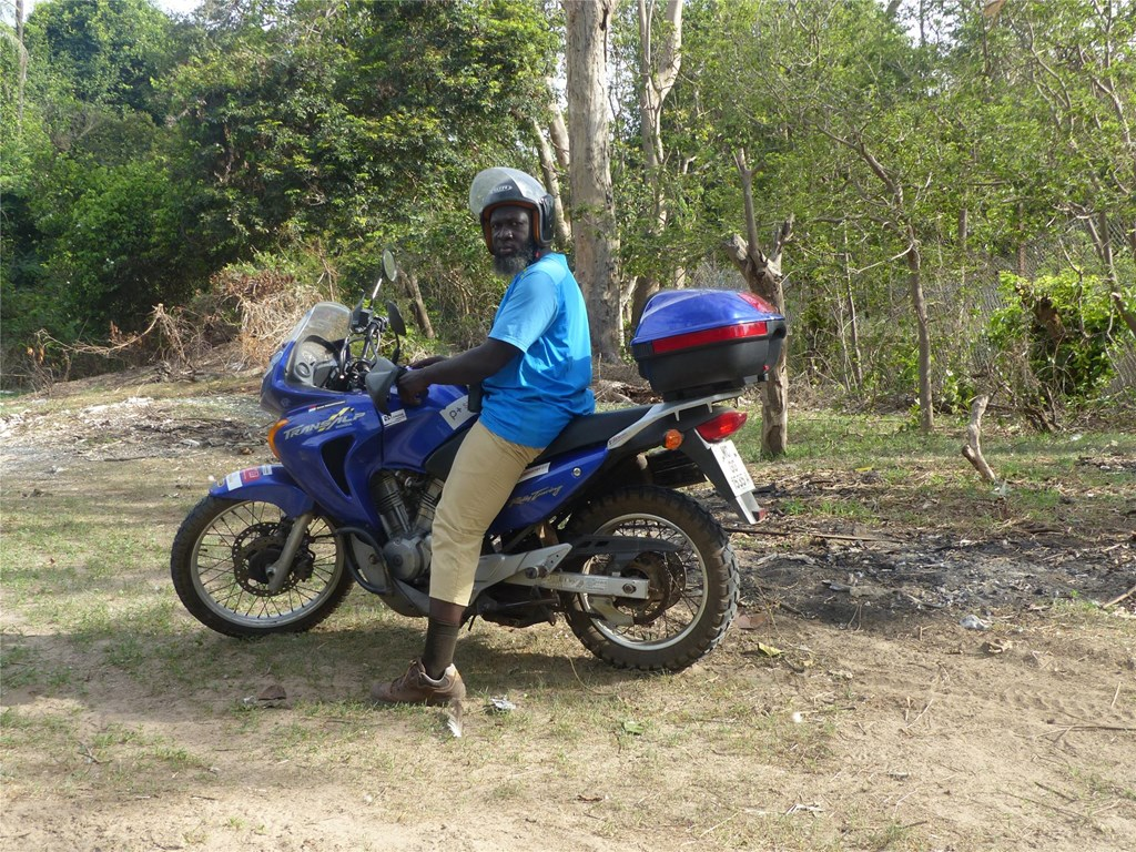 Momodou on his Motorbike While Doing Surveys in The Gambia