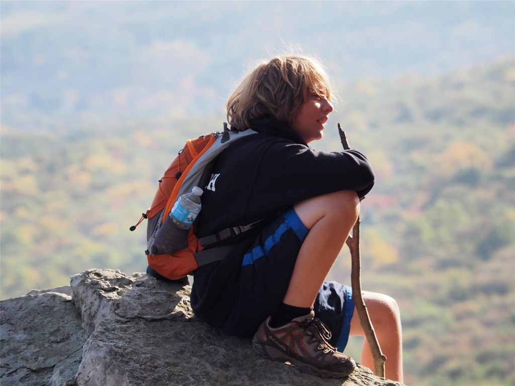 Young visitor sitting atop a boulder at South Lookout