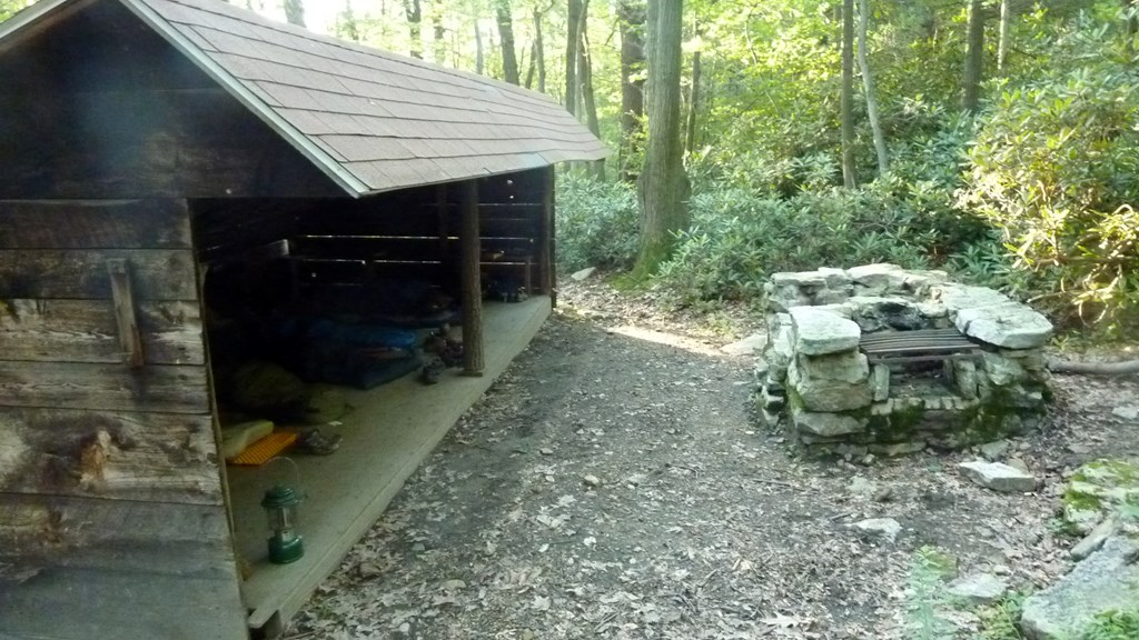 Adirondack shelter with fire pit
