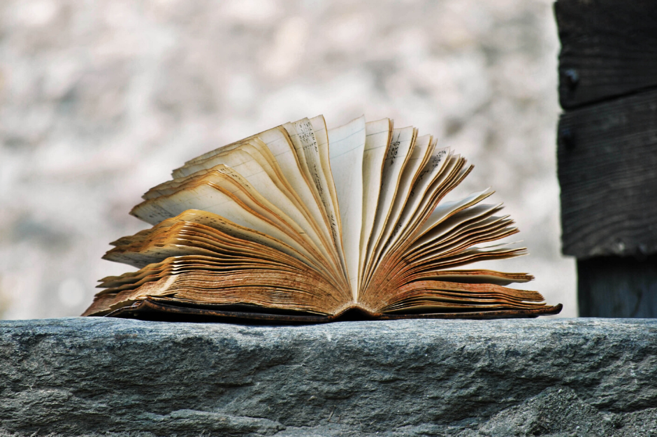 Book of stories on a rock ledge