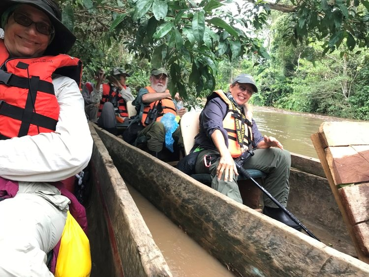 People in Dugout Canoes