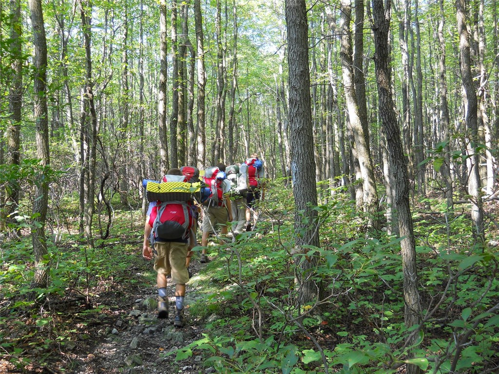 HM Conservation Corps backpacking through the forest