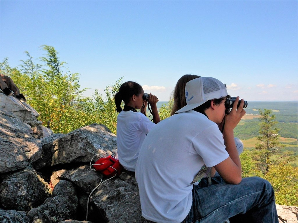 Summer Camp Participants use binoculars at North Lookout
